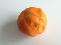 A dimpled clementine