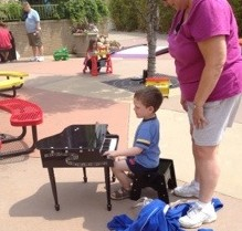 kid playing toy piano
