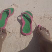 flip flops and feet on the beach