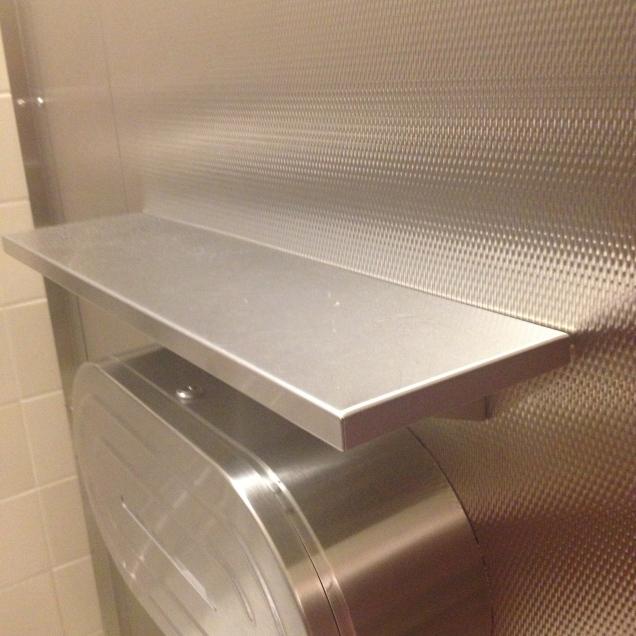 Toilet stall shelf