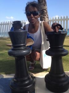 Mom with giant chess pieces.