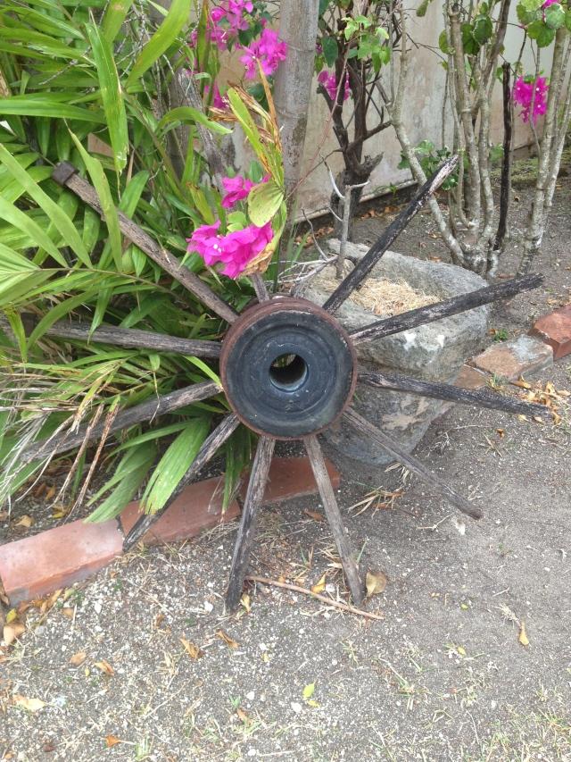 pink flowers surrounding a large wheel spoke