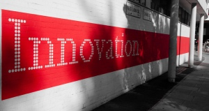 Red innovation on wall