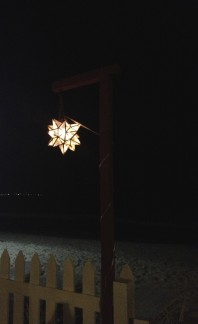 star-shaped light on beach