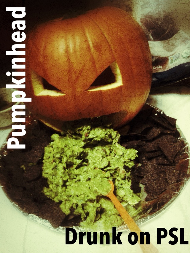 carved pumpkin vomiting guacamole onto blue corn chips