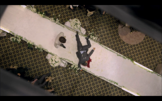 Dead body laying in front of groom
