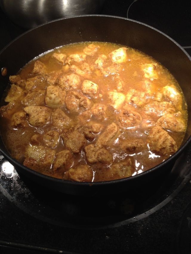 curry chicken cooking on stove