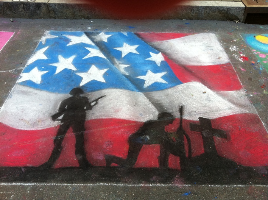 chalk drawing of American soldiers and flag