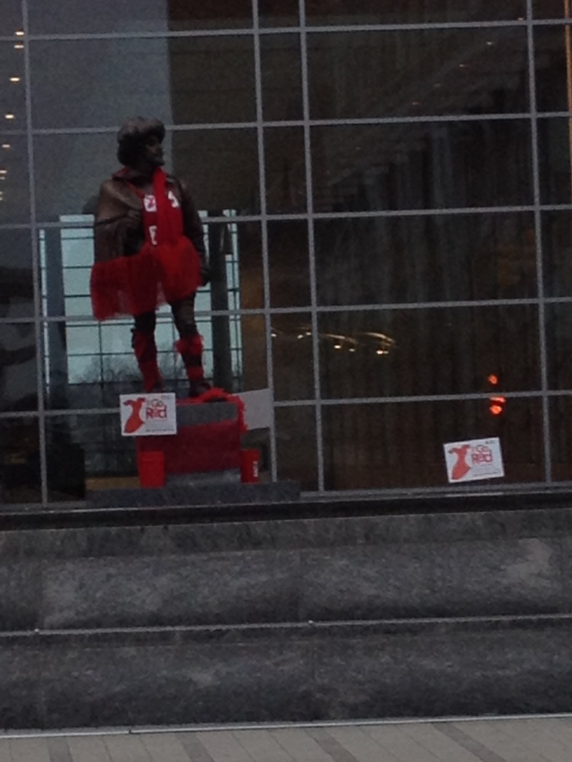 Sir Walter Raleigh statue wears a red dress for heart month