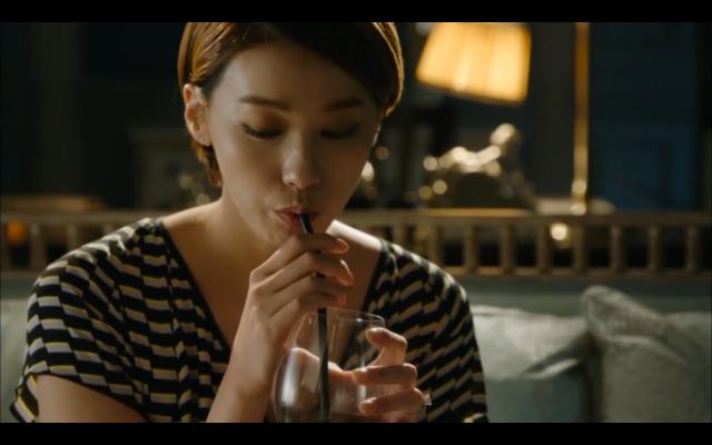 Mi Yeon drinks wine using a straw.