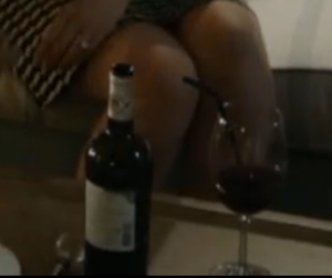 wine bottle and glass with a straw