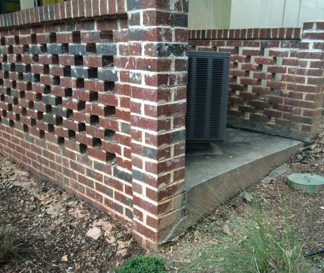 HVAC behind brick enclosure