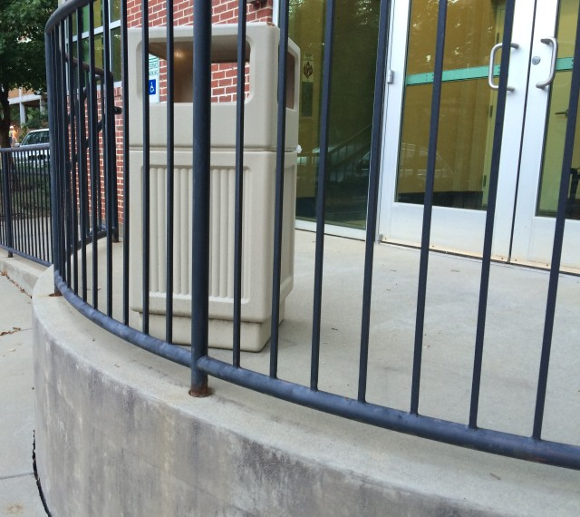 trash can behind bars