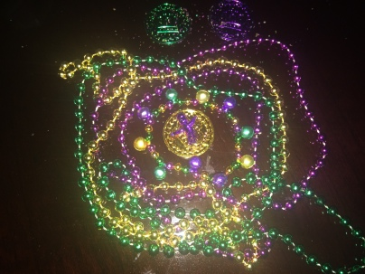 King cake baby, coins and beads