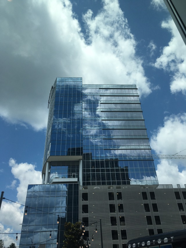 clouds reflection in mirrored building
