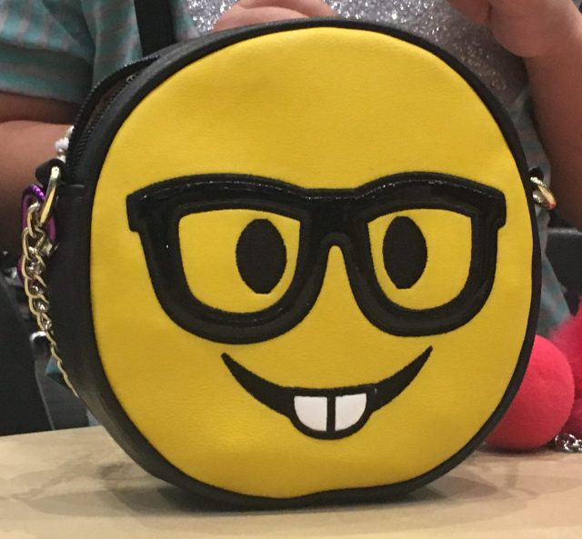 smiley face purse with glasses and teeth