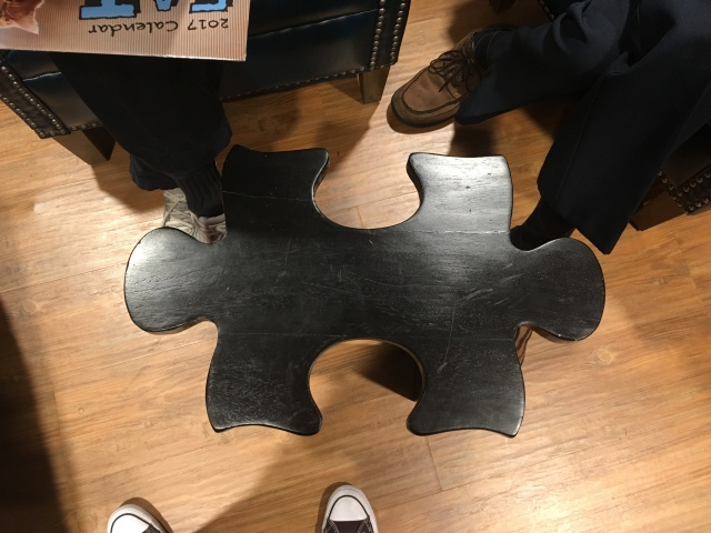 table shaped like a jigsaw puzzle piece