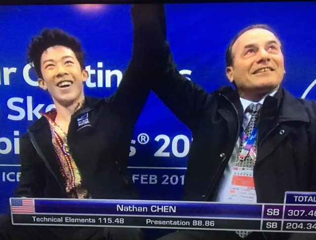 Nathan Chen sitting in kiss and cry area