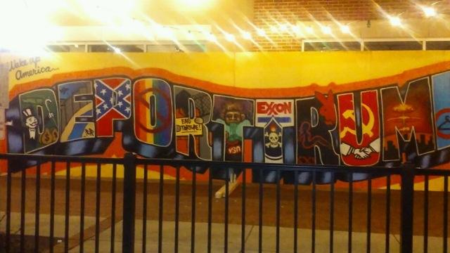 wall mural saying deport Trump