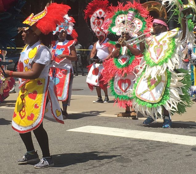 Parade participants dressed similar to cards