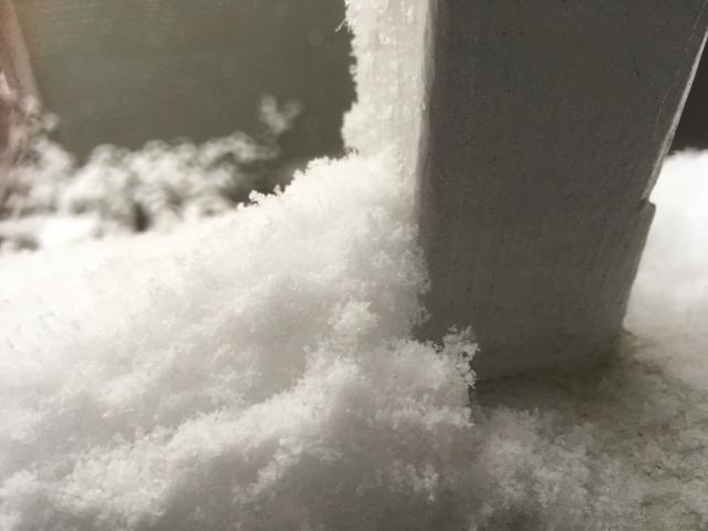 fresh snow on a rail